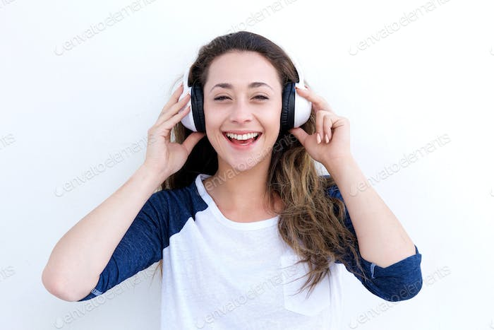 happy young woman laughing and listening to music with headphones