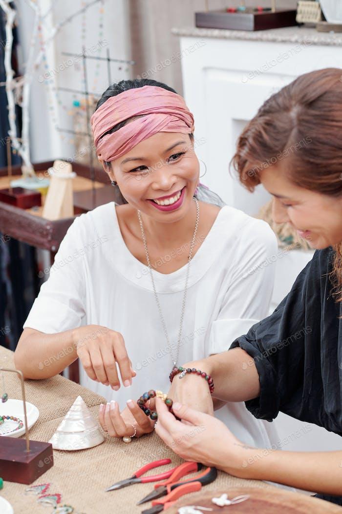 Friends making jewelry