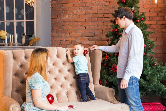 Christmas Family Portrait In Home Holiday Living Room, House Decorating By Xmas Tree Candles Garland