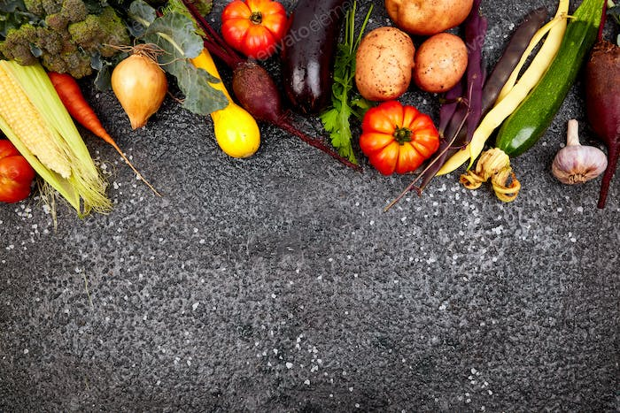 Different vegetables for eating healthy on black background.