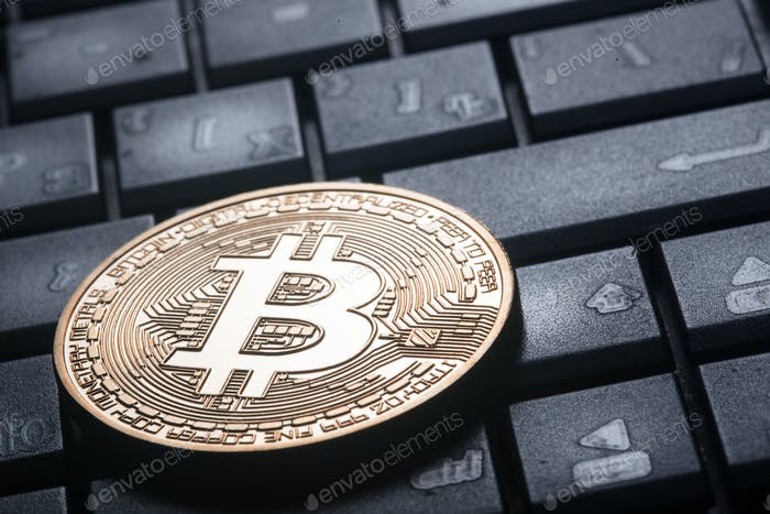 Crypto currency gold bitcoin on the computer keyboard