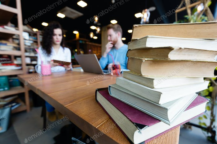 Portrait of students studying in bookstore together