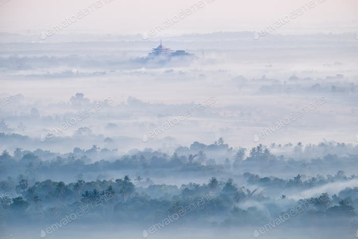 Watercolor view of foggy morning landscape. Hpa An, Myanmar