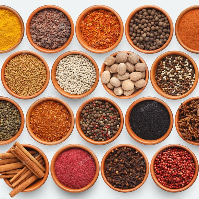 Different kinds of spices on white background