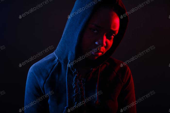 Colorful portrait of thoughtful cool woman with dark skin wearing hoodie