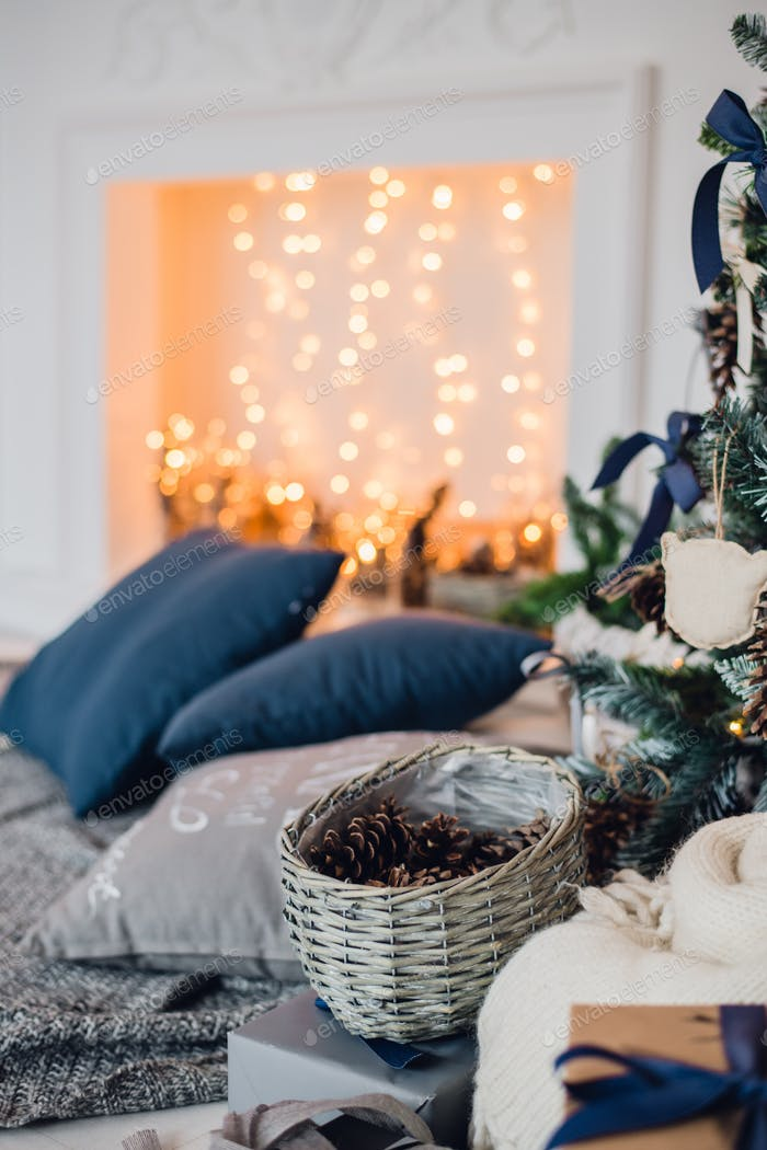 Christmas background with illuminated fir tree and fireplace at house