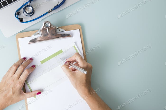 Doctor prescribing a medical recipe