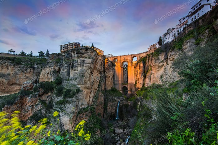 Evening view over iluminated New Bridge in Ronda, Spain