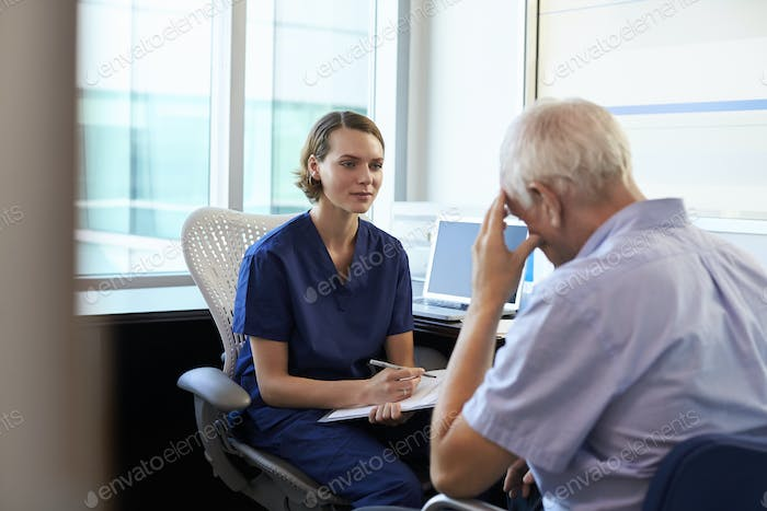 Doctor In Consultation With Depressed Male Patient