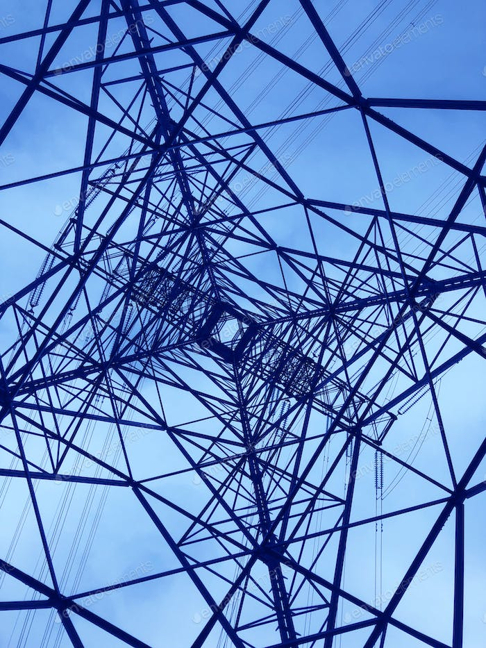 Power line tower viewed from above. Geometrical structure. Energy transmission