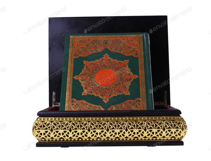 Quran in a black and gold box
