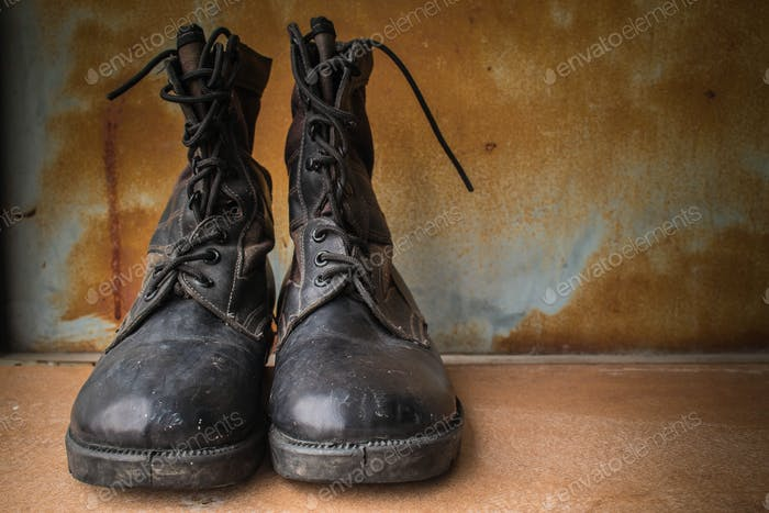 Combat boot on the old background
