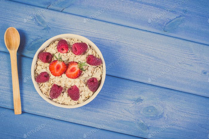 Oat flakes with strawberries and raspberries, healthy lifestyle and nutrition