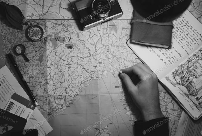 Aerial view of hand pinning on world map journey travel grayscal