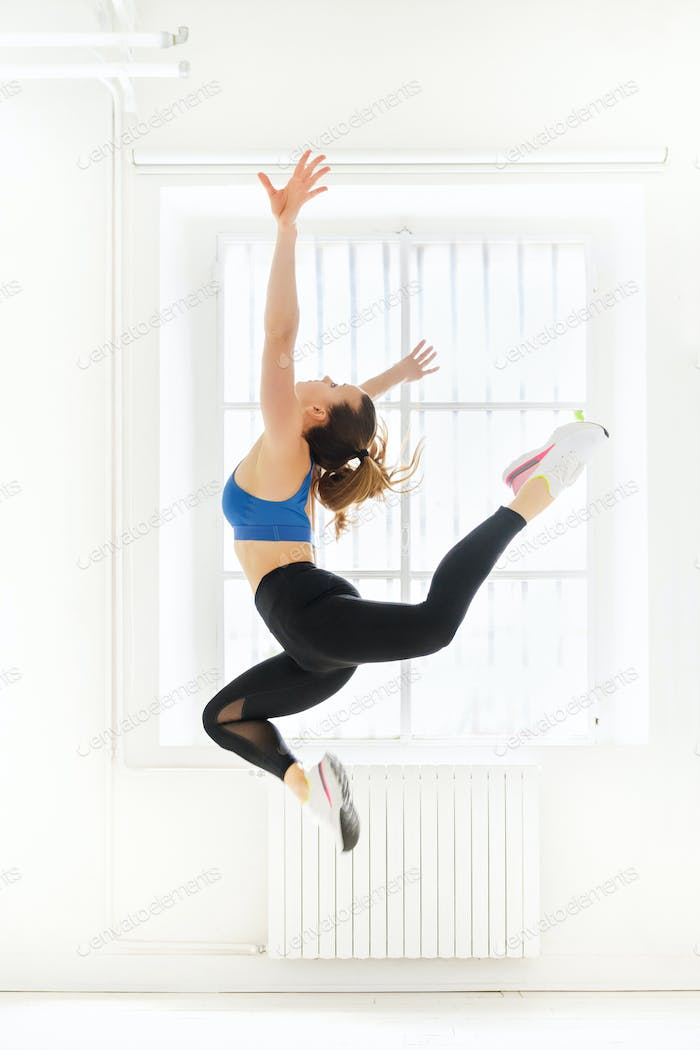 Woman doing an acro gymnastic butterfly jump