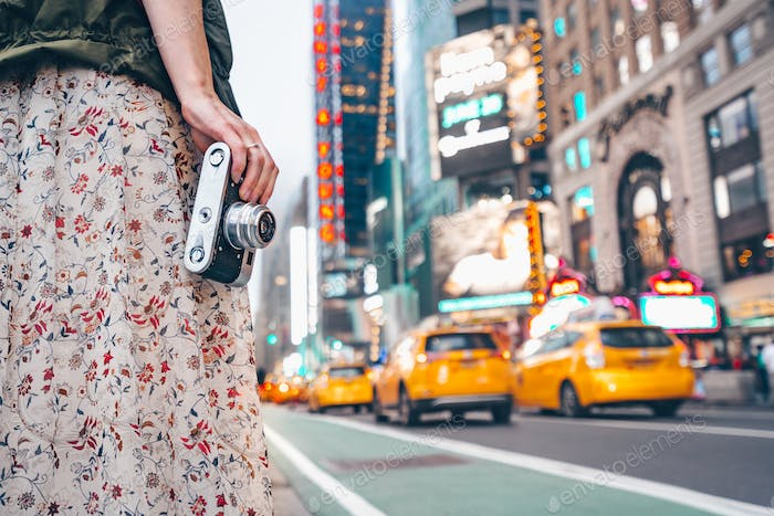 Young girl with a retro camera in Manhattan