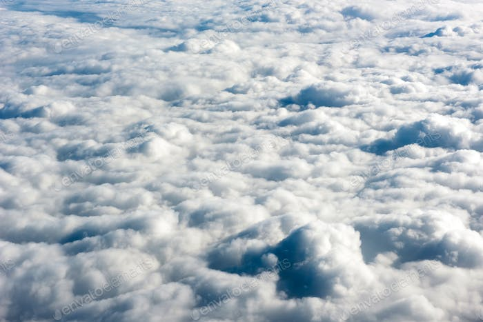 Close up view of fluffy clouds over a blue sky