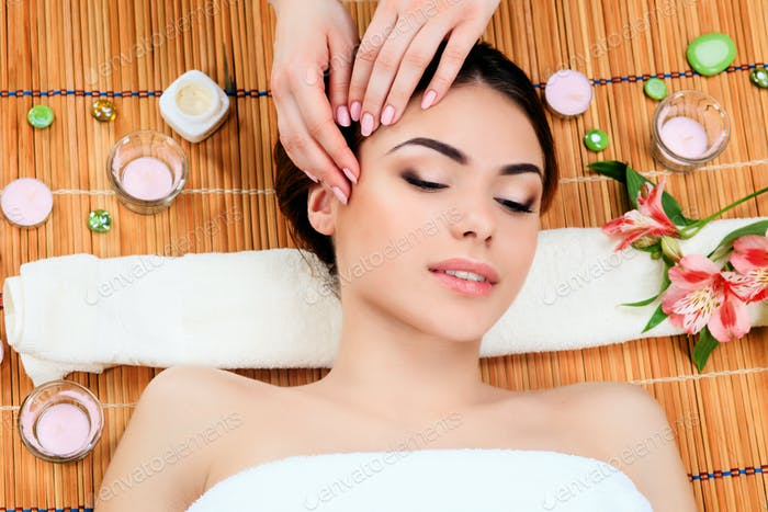 Beautiful young woman at a spa salon