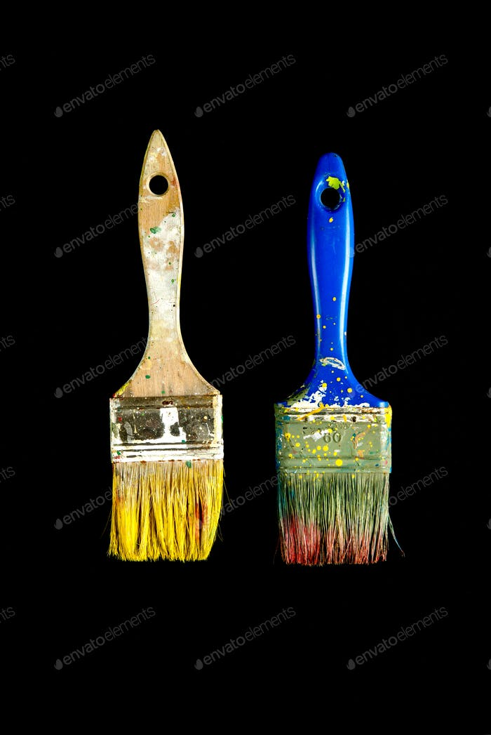 Two used brushes isolated on black