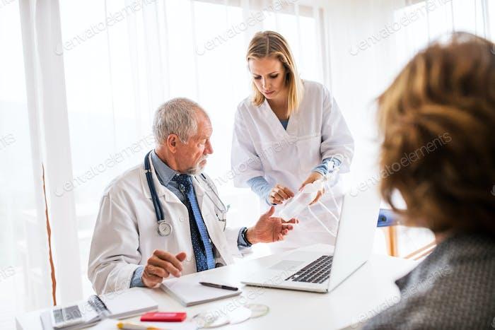 Senior doctor examining a senior woman in office.