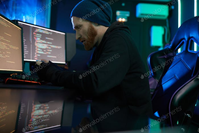 Computer hacker working at office
