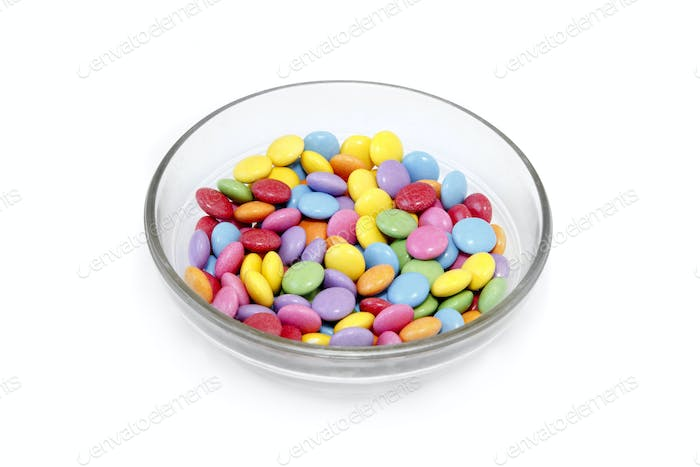 Bright colorful candy in glass bowl