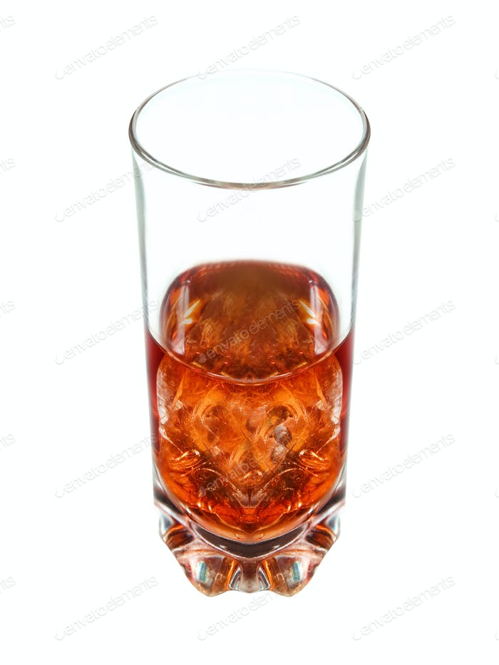 Glass of whiskey and ice isolated on white background