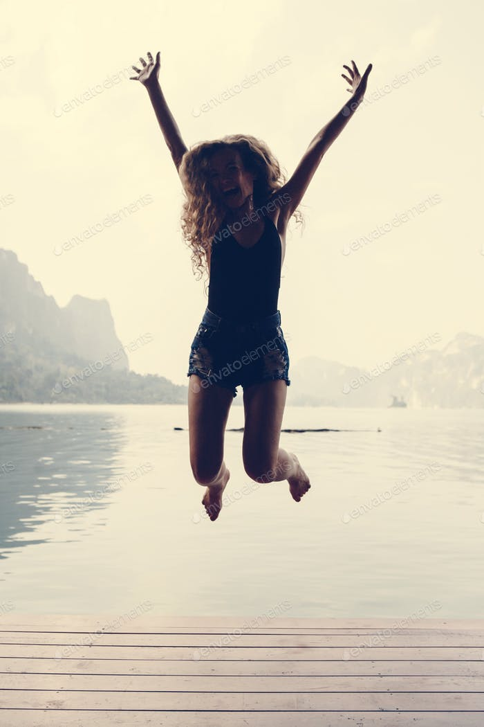 Happy woman jumping with joy