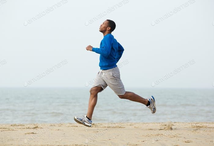 African american man running at the beach