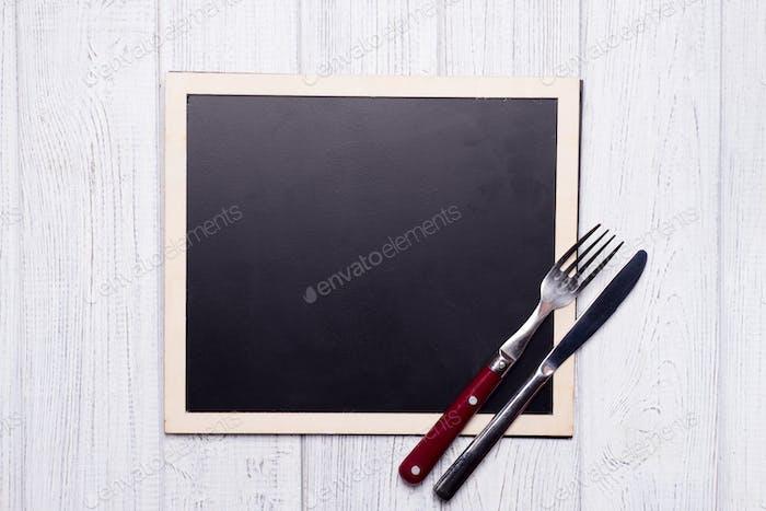 Menütafel mit Messer und Gabel