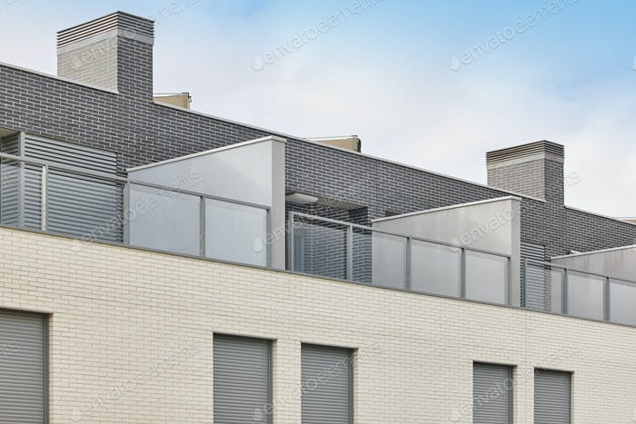 New building exterior facade attics with terrace. Construction. Buy, rent