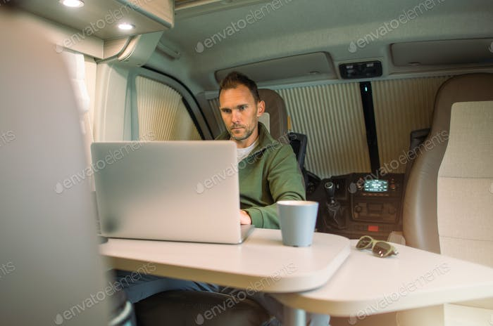 Men Working Straight From His Camper Van While on a Road Trip