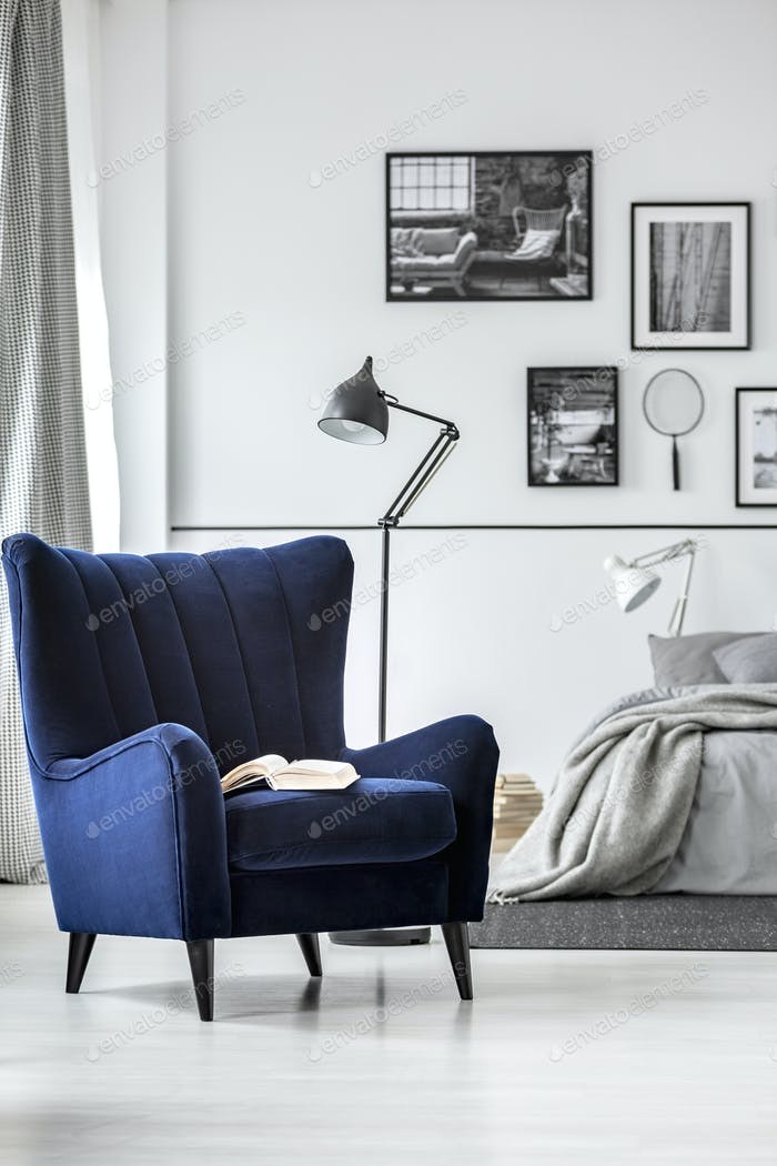 Trendy wing back chair in fancy bedroom interior with elegant furniture