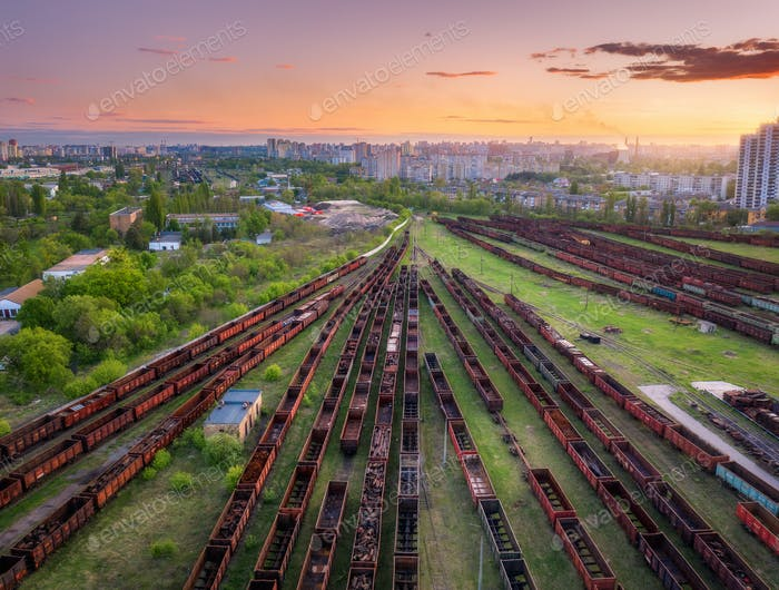 Aerial view of freight trains at sunset. Top view