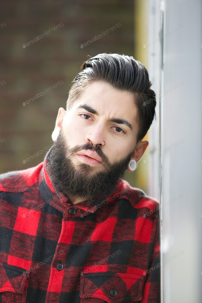 Gangster with beard and piercings