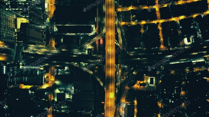 Top down night city traffic highway aerial. Lantern illuminate cityscape of Manila metropolis