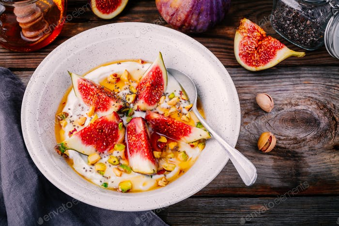 healthy breakfast. natural yoghurt with figs, pistachios nuts, chia seeds and honey