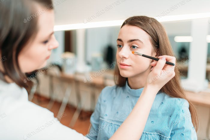 Professional beautician work with woman eyebrows