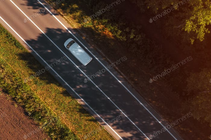 White van on the road, top down aerial view from drone pov