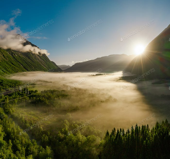 Morning mist over the valley among the mountains in the sunlight.