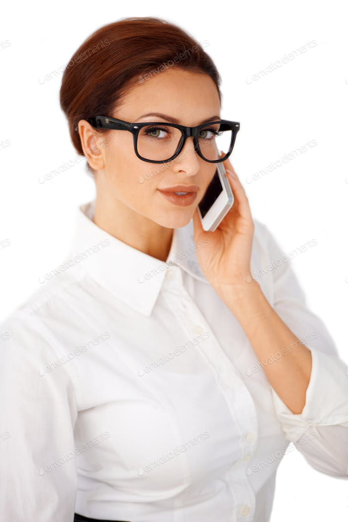 Businesswoman in glasses using a mobile
