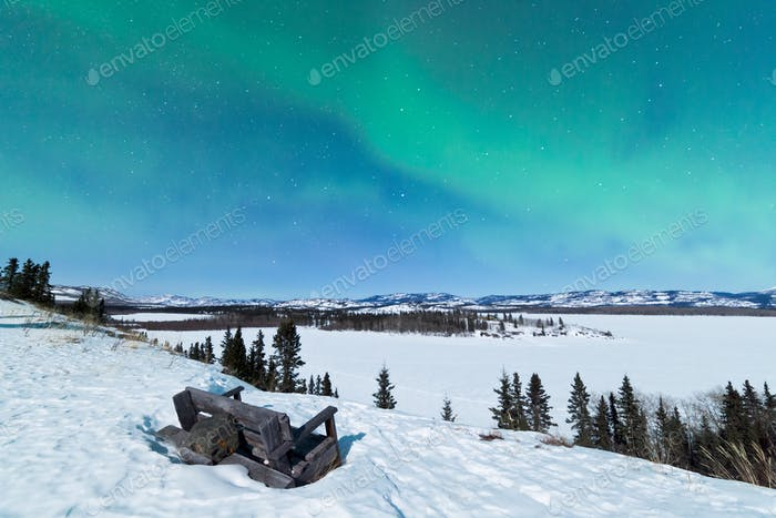 Bench looking on Lake Laberge with Northern Lights