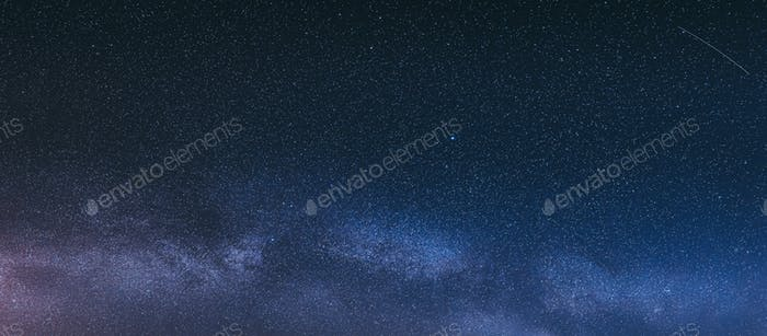 Real Colorful Night Sky Stars With Milky Way Galaxy. Natural Starry Sky Background. Panorama