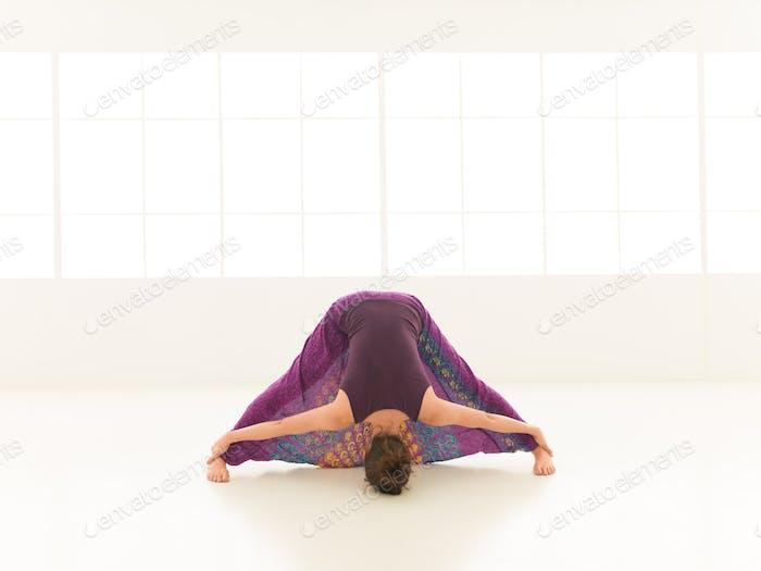 stretching yoga pose demonstration