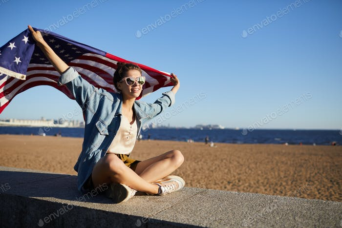 Beautiful woman with USA flag