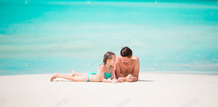 Panorama of father and his adorable little daughter at tropical beach