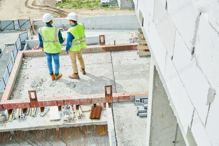 Modern constructors working on new house