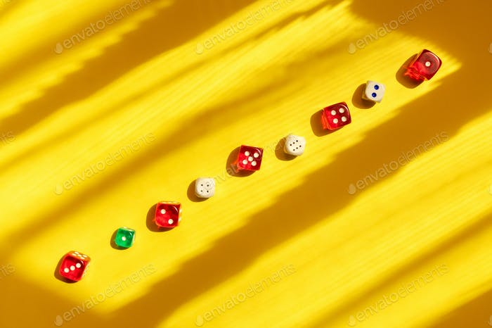 Dice row on yellow background.