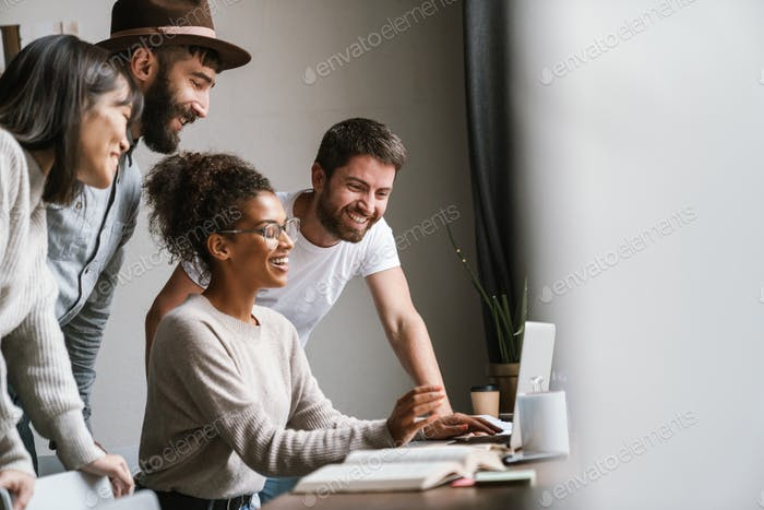 Image of multiethnic young business people working together at office