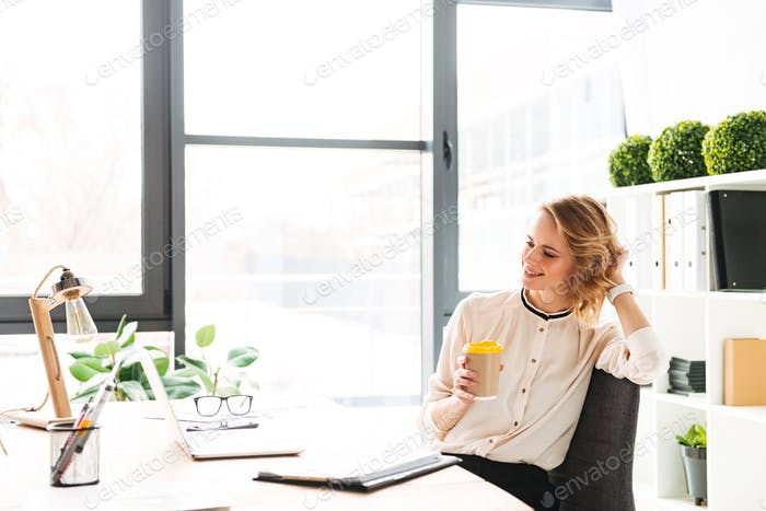 Portrait of a happy young businesswoman working